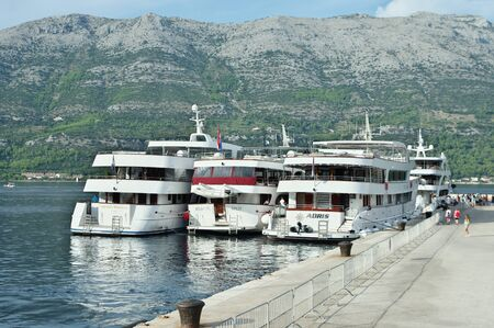 The city of Korcula on the island of Korcula, Croatia ? September 13, 2018: View from the port side. Cruise ships moored to the wharf.