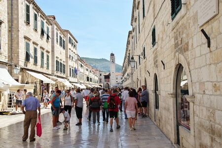 Dubrovnik, Dalmacija, Croatia – September 11, 2018: Stradun (Placa) str., Old Town. You can see the architecture typical of the region, some pubs, restaurants and shops. Many tourists are walki