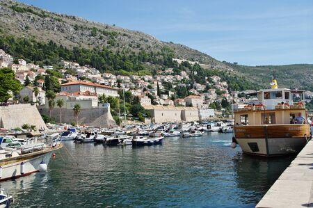 Dubrovnik, Dalmacija, Croatia - September 11, 2018: Old port - Old gap. You can see a lot of boats moored at the wharf.