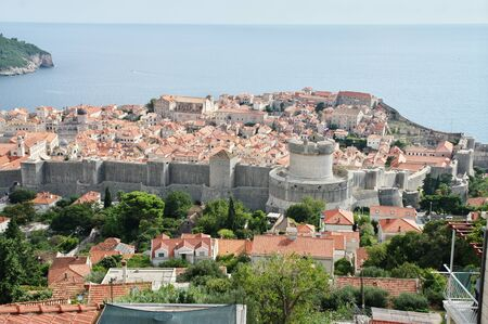 Dubrovnik, Dalmacija, Croatia – September 11, 2018: a general view from above of the old city. You can see defensive walls with towers and old Town.