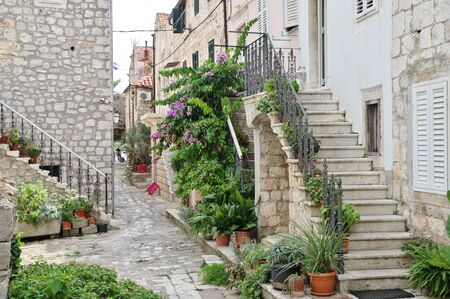 Mali Ston, Peljesac Peninsula, Dalmatia, Croatia – September 13, 2018: street in the old town. You can see vintage buildings made of stone - old architecture typical of the region.