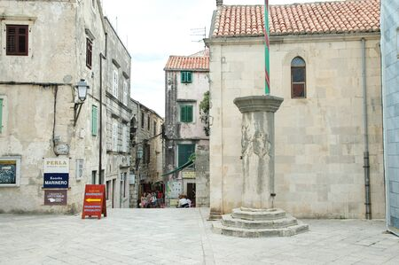 The city of Korcula on the island of Korcula, Croatia – September 13, 2018: Street in the old town. The typical architecture of the region is visible.