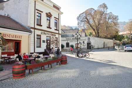 Tokaj, Hungary - October 16, 2018: Kossuth Ter, square in the center of the city. In the depths you can see Rakoczi's wine cellar and statue of Bacchus.
