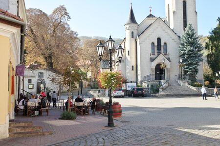 Tokaj, Hungary - October 16, 2018: Kossuth Ter, square in the center of the city. View of the Heart of Jesus Church. 에디토리얼