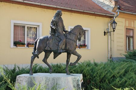 Tokaj, Hungary - October 16, 2018: Rakoczi street,  monument to Ferenc Rakoczi. You can see the architecture typical of the region. 에디토리얼