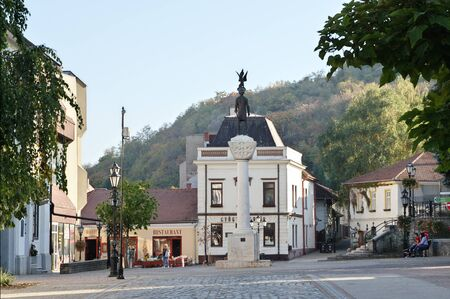 Tokaj, Hungary - October 16, 2018: Kossuth Ter, square in the center of the city. The statue of King Saint Stephen. On the right, in the background, you can see the wine cellar of Ferenc Rákóczi