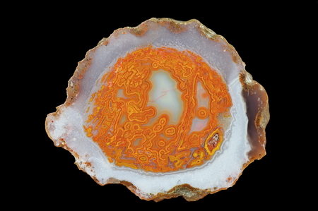 A cross section of the eyelet agate stone. Multicolored silica rings colored with metal oxides are visible.