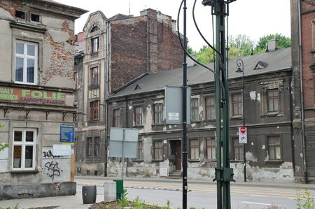 Krakow, Poland – May 12, 2019: district of Podgórze, Limanowskiego street. Old tenement houses for renovation are located along the street