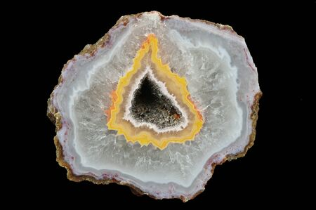 Filled with quartz. In the center silica ring coloured by metal oxides and geode. Stock Photo