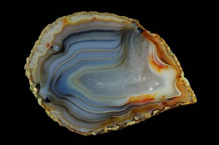 Concentric agate filled with quartz. Numerous colored ribbons colored with metal oxides are visible. Origin: Rudno near Krakow, Poland.