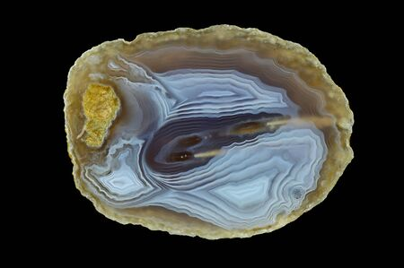 Spherical agate. Numerous colored ribbons colored with metal oxides are visible. Origin: Rudno near Krakow, Poland.