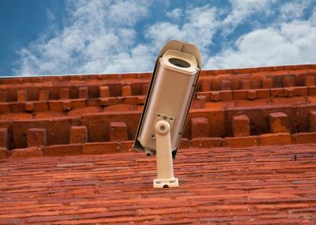 The camera on the brick wall Stock Photo - 19159754