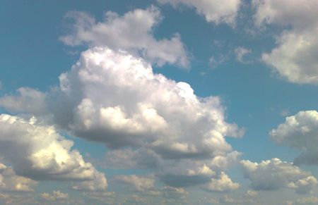 The blue sky with white and grey clouds. Stock Photo