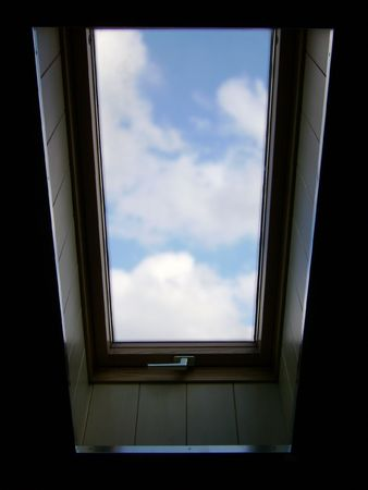 The sky in a window on an attic Stock Photo