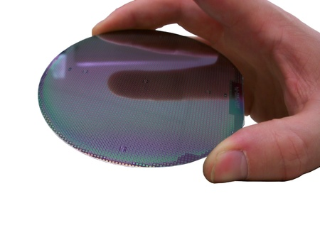 Silicone wafer in the hand, isolated Stock Photo