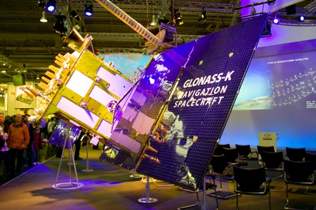 HANNOVER, GERMANY - MARCH 5, 2011: stand of the Glonass-K in CEBIT computer expo, Hannover, Germany. GLONASS-K is the latest satellite design intended as a part of the Russian GLONASS radio-based satellite navigation system