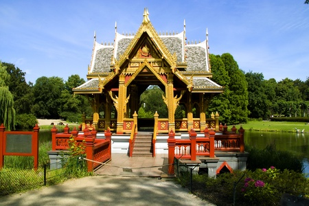 The Asian pagoda against lake and wood