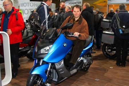 tage: HAMBURG, GERMANY - JANUARY 26: a man on the BMW motorbike  on January 26, 2013 at HMT (Hamburger Motorrad Tage) expo, Hamburg, Germany. HMT is a large motorcycle expo Editorial