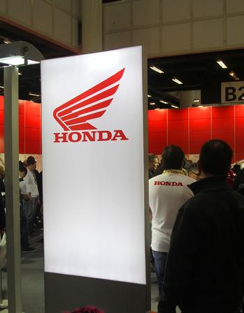tage: HAMBURG, GERMANY - FEBRUARY 22: Stand of Honda on February 22, 2014 at HMT (Hamburger Motorrad Tage) expo, Hamburg, Germany. HMT is a large motorcycle expo