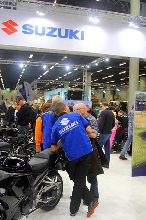 tage: HAMBURG, GERMANY - FEBRUARY 22: Stand of Suzuki on February 22, 2014 at HMT (Hamburger Motorrad Tage) expo, Hamburg, Germany. HMT is a large motorcycle expo Editorial