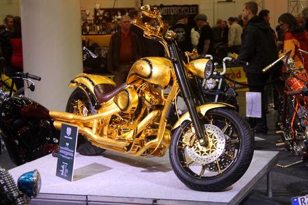 tage: HAMBURG, GERMANY - FEBRUARY 22: The gold motorcycle on February 22, 2014 at HMT (Hamburger Motorrad Tage) expo, Hamburg, Germany. HMT is a large motorcycle expo Editorial