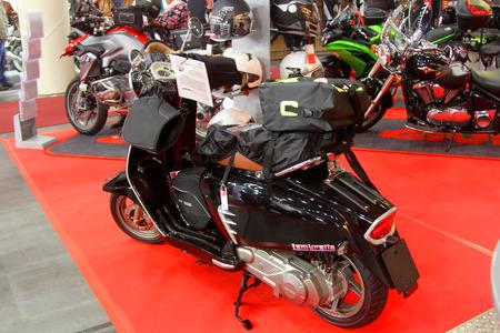 tage: HAMBURG, GERMANY - FEBRUARY 22: The black motorscooter on February 22, 2014 at HMT (Hamburger Motorrad Tage) expo, Hamburg, Germany. HMT is a large motorcycle expo Editorial