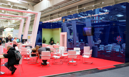 educations: HANNOVER, GERMANY - MARCH 13: Stand of russian ministry of educations and science on March 13, 2014 at CEBIT computer expo, Hannover, Germany. CeBIT is the worlds largest computer expo
