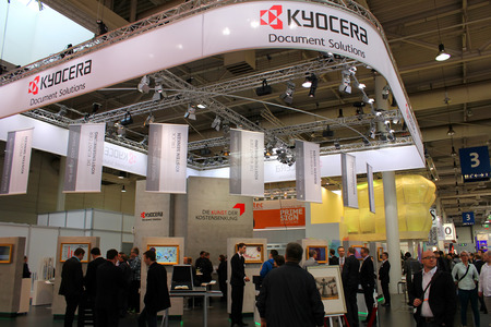 HANNOVER, GERMANY - MARCH 13: The stand of Kyocera on March 13, 2014 at CEBIT computer expo, Hannover, Germany. CeBIT is the world's largest computer expo Editorial