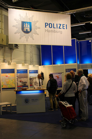 october 31: HAMBURG, GERMANY - OCTOBER 31: Stand of the Water Police on the Hanseboot Expo on October 31, 2014 at Hanseboot - the international boat show, Hamburg, Germany.
