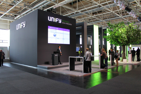unify: HANNOVER, GERMANY - MARCH 20: The presentation of Unify on March 20, 2015 at CEBIT computer expo, Hannover, Germany. CeBIT is the worlds largest computer expo