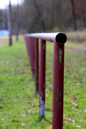 metal pipes: A fence made of metal pipes Stock Photo