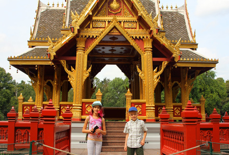 Two little tourist on the asian pagoda background Stock Photo