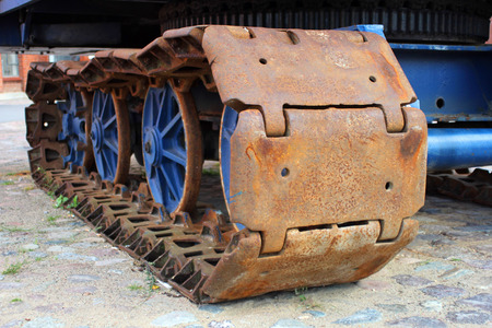 crawler: The old rusty caterpillar of the crawler tractor
