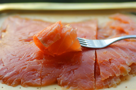 The smoked salted salmon on the fork