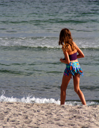 The teenage girl on the sea beach. Stock Photo