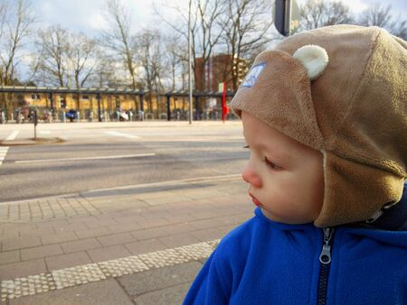 The portrait of the little boy outdoors. Stock Photo