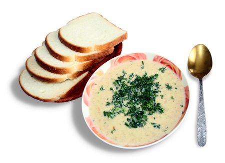 Vegetable cream soup with a parsley and the roasted toasts Stock Photo