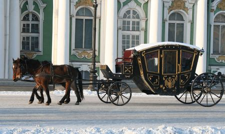 old carriage at square near with on a winter palace Stock Photo