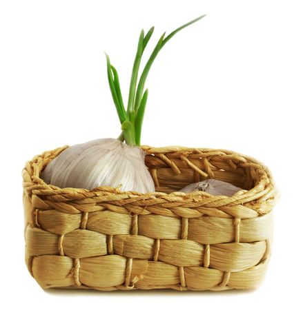 garlic in a small basket Stock Photo
