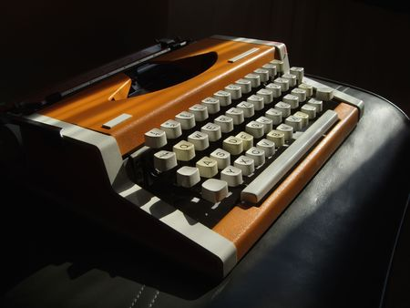 Mechanical typewriter on a black bacground Stock Photo