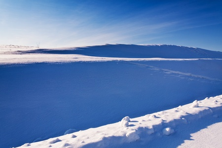 snow slope in the shade of a bright winter day Stock Photo