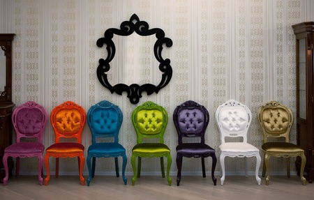 series multicolored chairs for sale, facing along the wall with a mirror