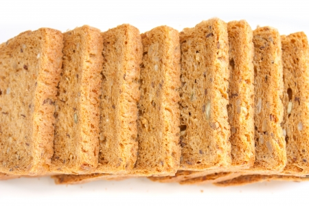Fresh baked bread with seeds, for sandwiches, cut into neat slices