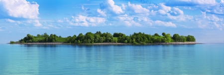 panoramic nature: green island in a sea of turquoise water