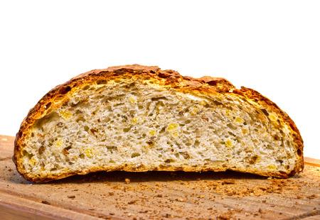 round loaf of rye bread, cut in half, lying on a wooden board