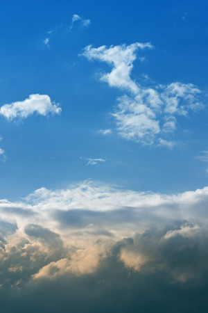 white cumulus clouds against a bright blue sky without the sun