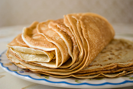 a pile of freshly cooked pancakes on a plate