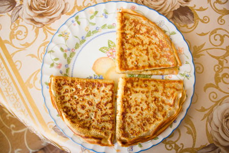 three pancake, folded triangle on the plate