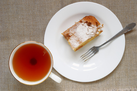 tea and a piece of apple pie on a cover Stock Photo