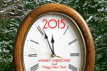 number 12: new year clock with 2015 instead of number 12 on the background of snow-covered fir trees Stock Photo